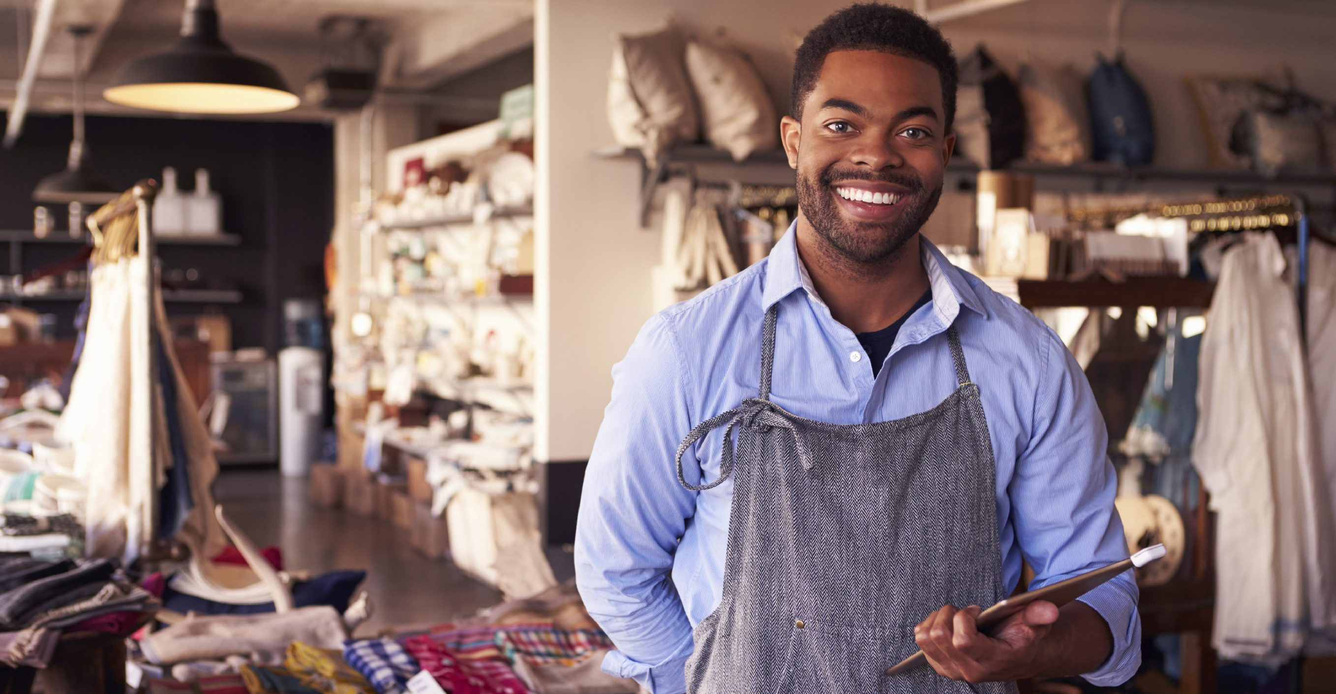 Portrait Of Male Owner Of Gift Store With Digital Tablet